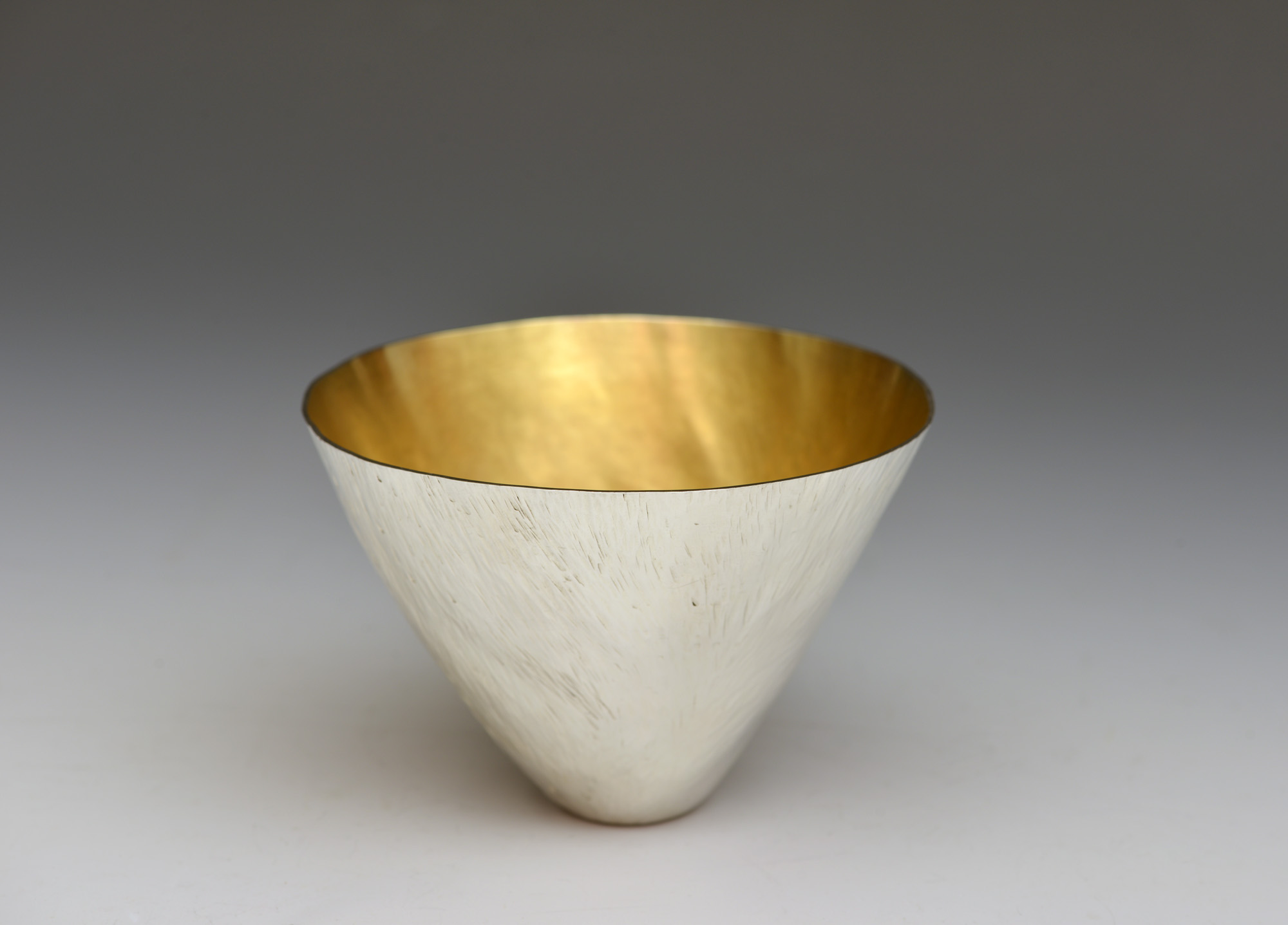 Water beaker by Rebecca-Anne Boldra: made of Britannia Silver, plannished with an internal gold hard plate and commissioned in 2017