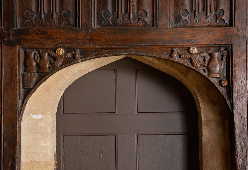 Hall Boy Carvings over the Buttery Door