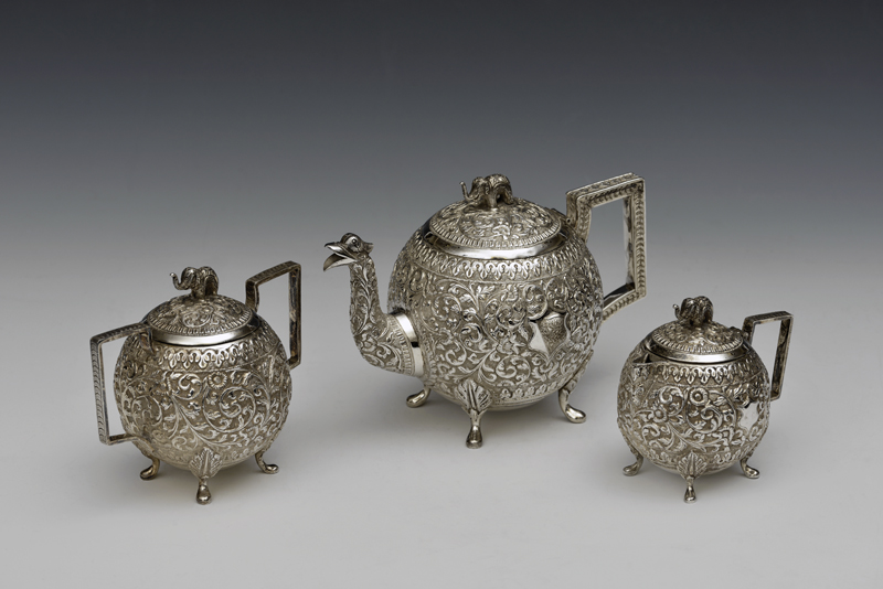 Tea service made of embossed Indian silver; gifted to College by the Librarian in 2015