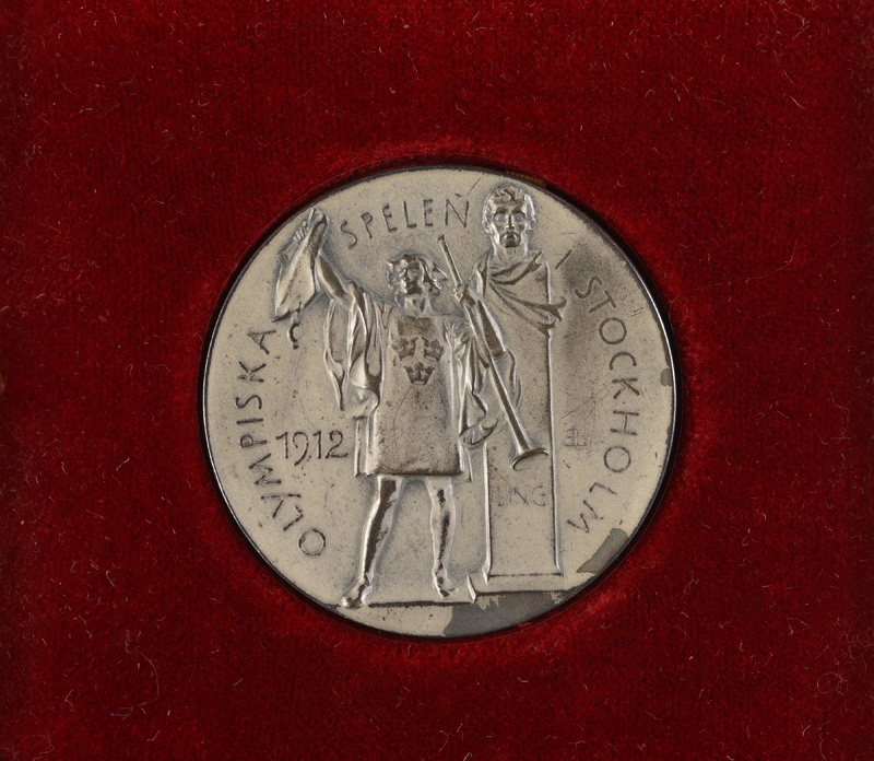 Personal silver rowing medal from the 1912 Stockholm Olympic Games; presented to Tom Gillespie