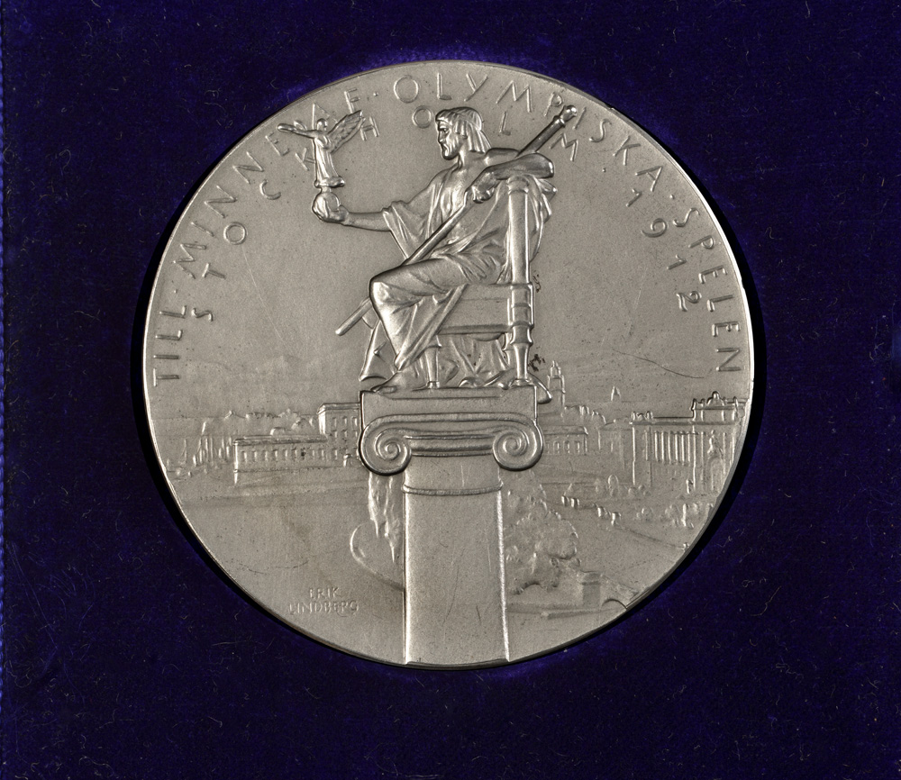 Team silver rowing medal from the 1912 Stockholm Olympic Games; presented to Tom Gillespie and gifted to College by his family.