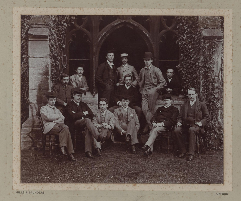NCA JCR/Q2/3, Photograph of New College Essay Society members, including Herbert A.L. Fisher (back row, in subfusc) and Campbell Dodgson, future Keeper of Prints & Drawings at the British Museum and son-in-law of Warden Spooner (front row, third from left), 1888