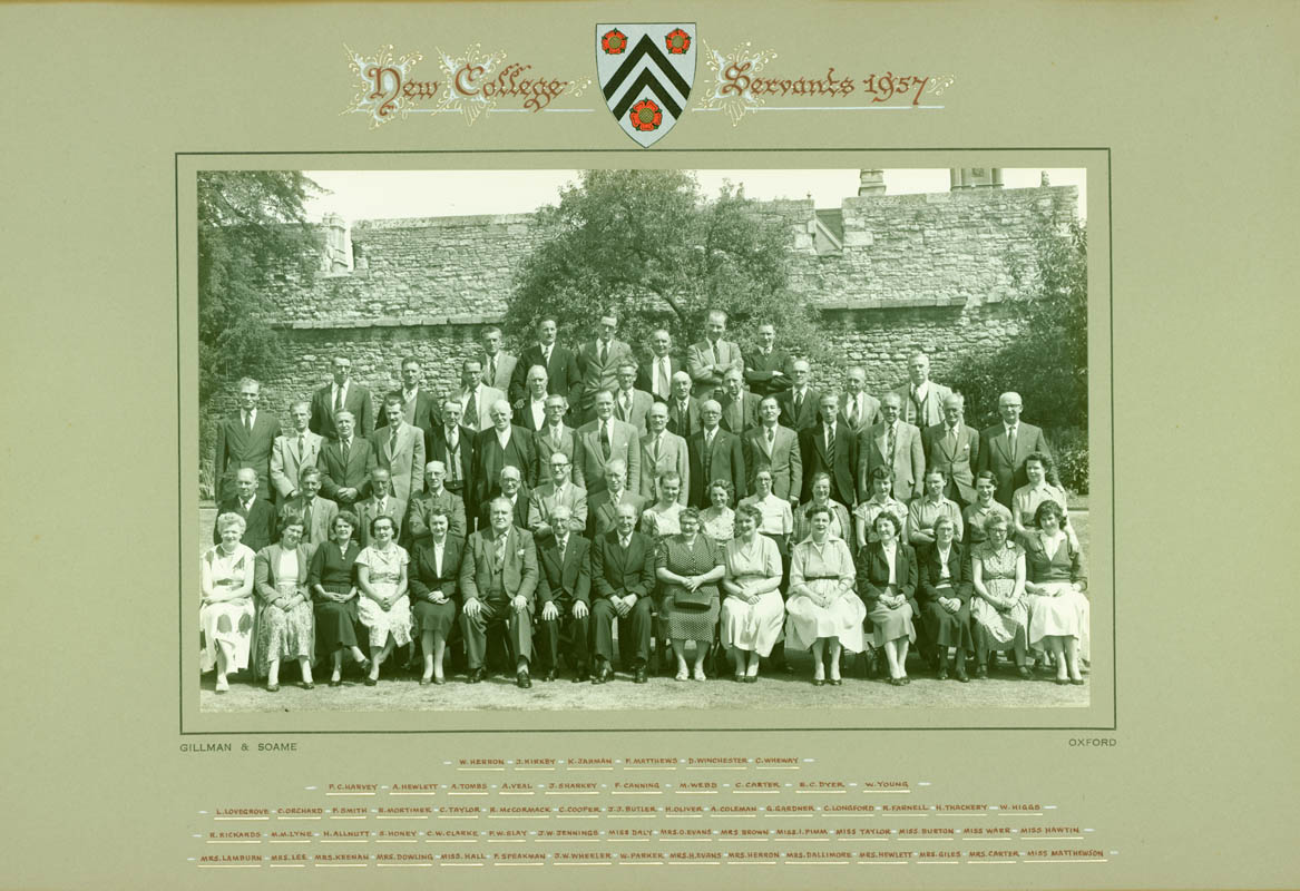 NCA DB/11, Photograph of New College servants, in front of Oxford's medieval city wall in New College Gardens, c. 1957-58 (© Gillman & Soame)