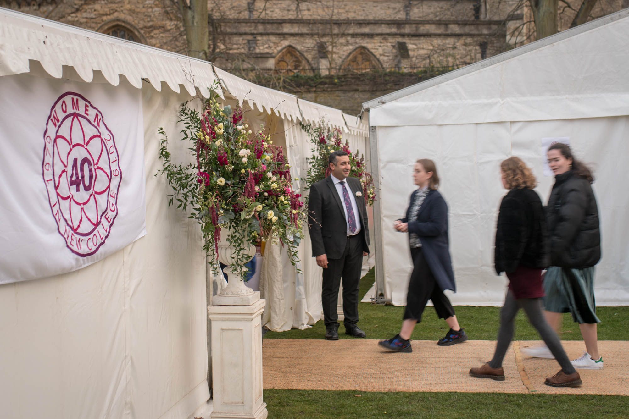 Attendees enter the marquee in the Gardens