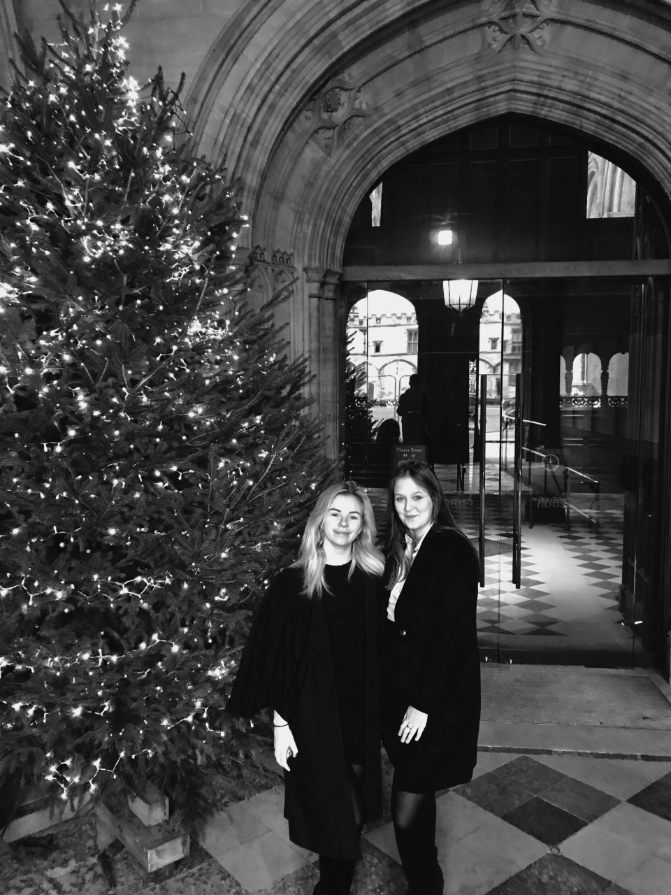 Beth Arrowsmith and Ruth Flame standing next to a Christmas tree