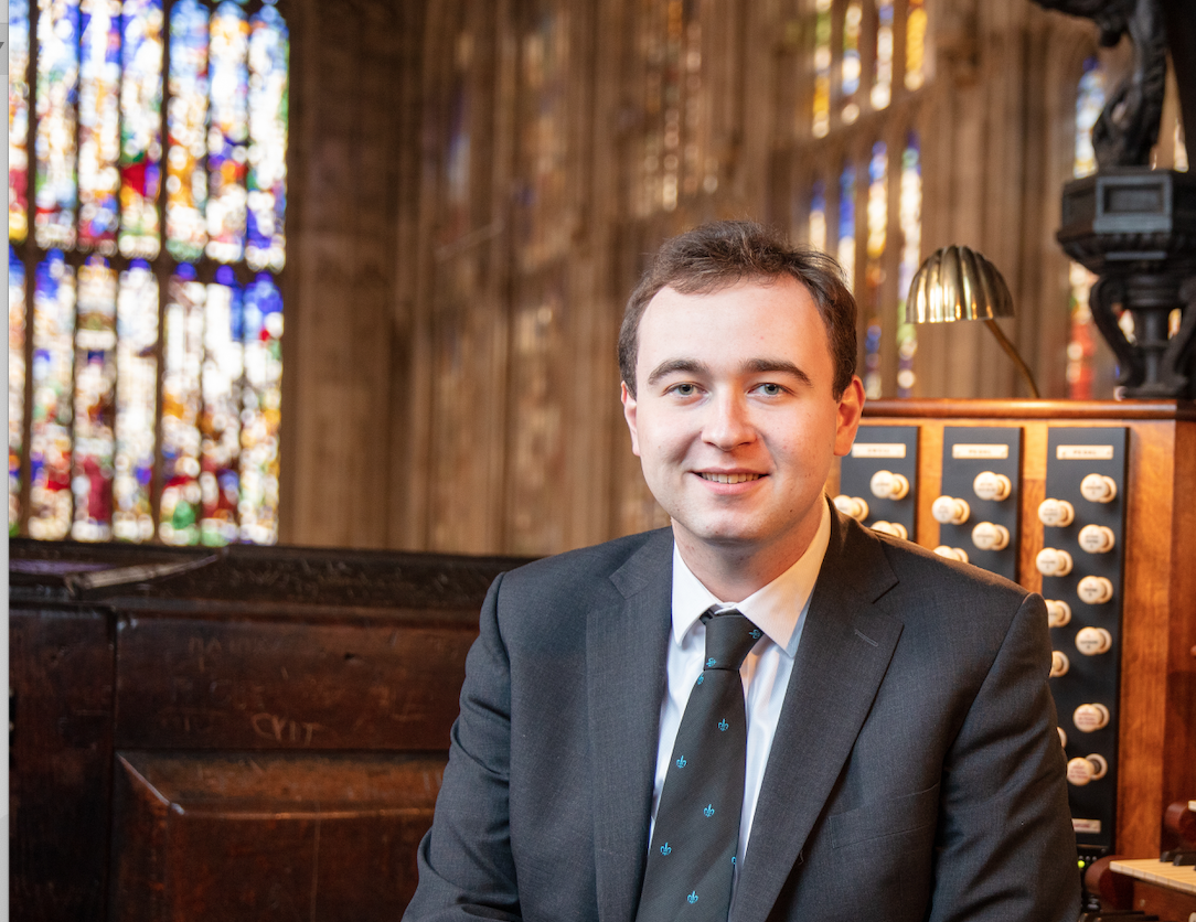 Photo of Mr McCann seated at the organ