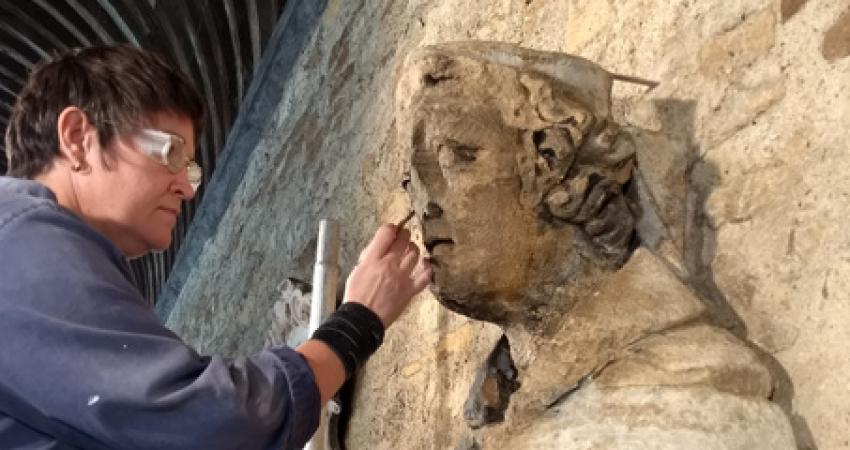restoring the statue