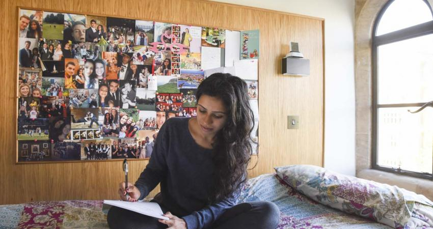 A Student in their room studying