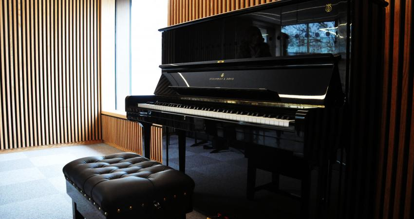 Steinway upright piano in a practice room