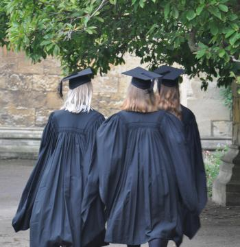 Students in mortarboards and gowns in the Front Quad