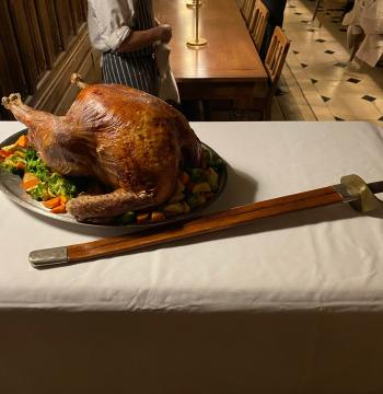 Roast turkey and a New College sword for carving